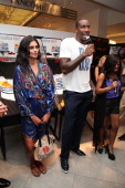 Rachel Roy and Amar'e Stoudemire attend Fashion's Night Out at Macy's Herald Square on September 8 2011 in New York City