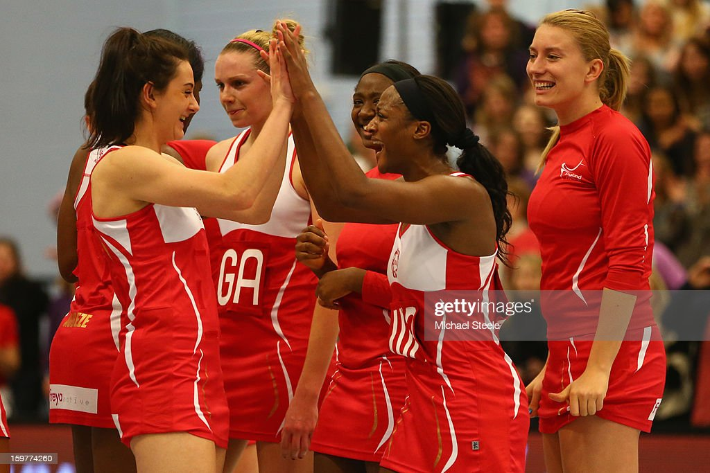 Rachel Shaw (L) and Sasha Corbin (R) of England celebrate their 58-53 victory during the England v Australia International Netball Series match at the University of Bath on January 20, 2013 in Bath, England.