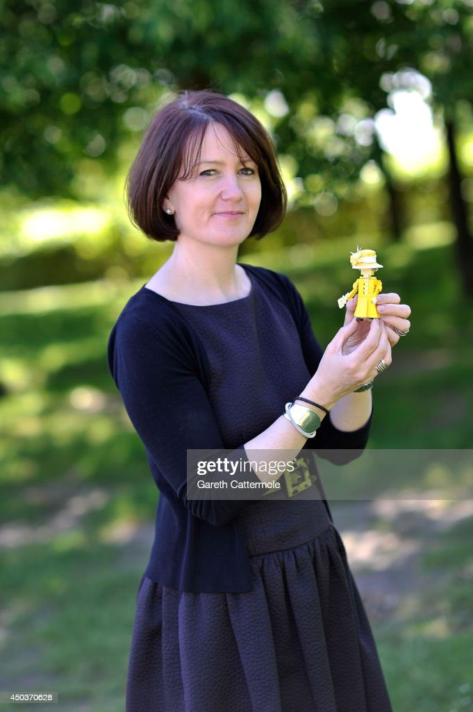 Rachel Trevor-Morgan, The Queen's milliner holds a LEGO figure of Queen Elizabeth II wearing one of her creations ahead of Royal Ascot at LEGOLAND Windsor on June 10, 2014 in Windsor, England.