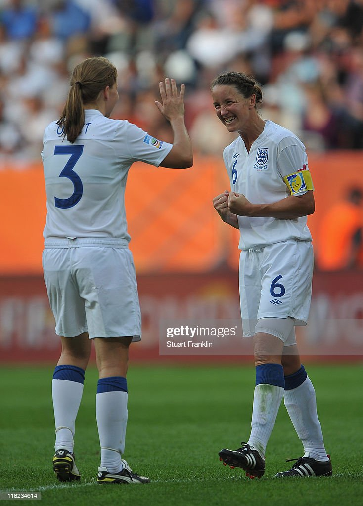 Rachel Unitt and captain Casey Stoney of England celebrate at the end of the FIFA Women's World Cup 2011 group B match between England and Japan at the FIFA World Cup stadiumon July 5, 2011 in Augsburg, Germany.