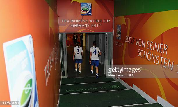 Rachel Unitt and Jill Scott of England leave the pitch at the end of the FIFA Women's World Cup 2011 Group B match between Mexico and England at the...