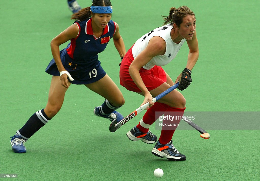 Rachel Walker of England takes control of the ball in front Qiuqi Chen of China during the 2003 Women's BDO Hockey Champions Trophy match between...