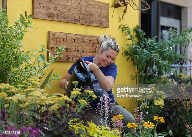 Rachel Walker of Walker Landscape Design adds the finishing touches to the Bee Garden designed for the NSPCC at the Dig The City garden festival on...