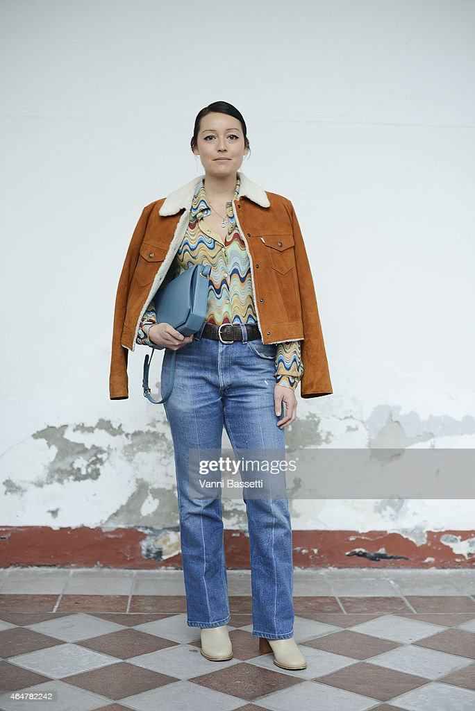 Rachel Wang poses wearing Levi's jacket and Candamill bag on February 28 2015 in Milan Italy