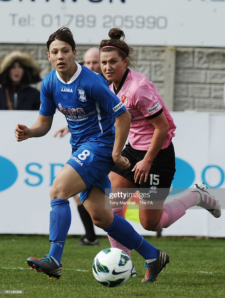 Rachel Williams of Birmingham City (L) and Amy Turner of Lincoln Ladies in action during the FA Women's Super League match between Birmingham City Ladies FC and Lincoln Ladies FC at DCS Stadium, Stratford Town FC on April 21, 2013 in Stratford, England.
