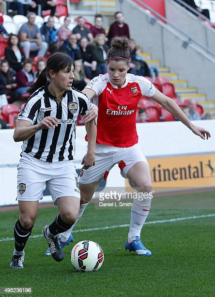 Rachel Williams of Notts Ladies County FC maintains control over Dominique Janssen of Arsenal Ladies FC during the WSL Continental Cup Final between...