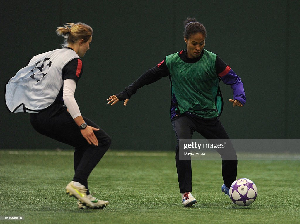 <a gi-track='captionPersonalityLinkClicked' href=/galleries/search?phrase=Rachel+Yankey&family=editorial&specificpeople=235431 ng-click='$event.stopPropagation()'>Rachel Yankey</a> is closed down by <a gi-track='captionPersonalityLinkClicked' href=/galleries/search?phrase=Ellen+White&family=editorial&specificpeople=4436830 ng-click='$event.stopPropagation()'>Ellen White</a> of Arsenal Ladies during an Arsenal Ladies Training Session at Arsenal Training Ground on March 19, 2013 in St. Albans, Hertfordshire, England.