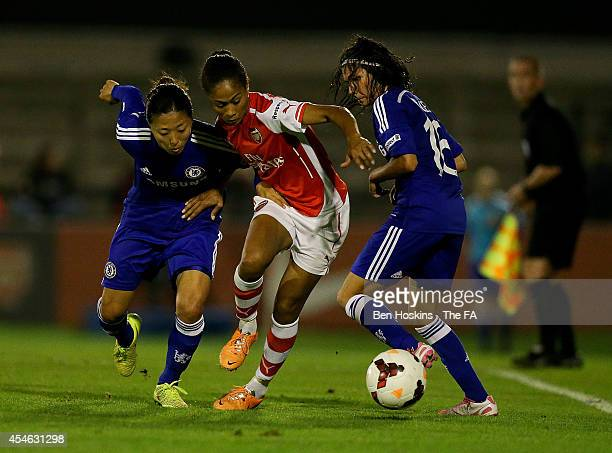 Rachel Yankey of Arsenal holds off pressure from Yuki Ogimi of Chelsea during the WSL match between Arsenal Ladies and Chelsea Ladies at Borehamwood...