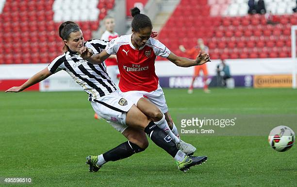 Rachel Yankey of Arsenal Ladies FC is tackled by Amy Turner of Notts Ladies County FC during the WSL Continental Cup Final between Arsenal Ladies FC...