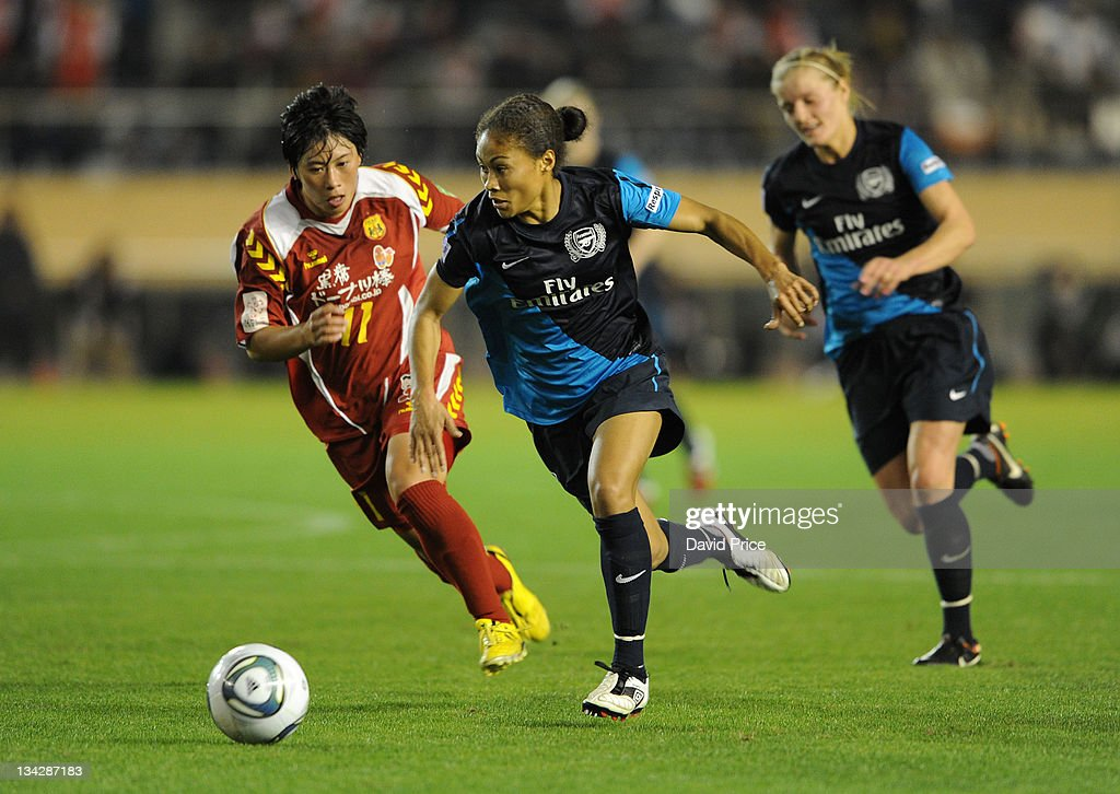 Rachel Yankey of Arsenal Ladies FC (C) takes on Megumi Takara of INAC during a friendly game against INAC Kobe at the Nishigaoka Stadium on November 30, 2011 in Tokyo, Japan.