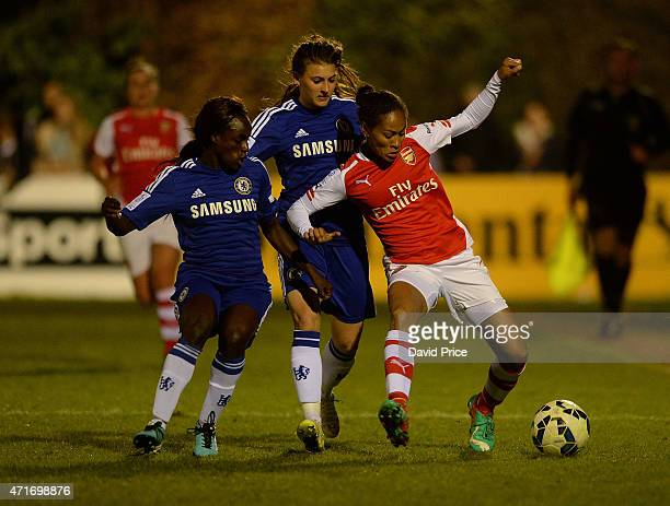 Rachel Yankey of Arsenal Ladies takes on Eniola Aluko and Hannah Blundell of Chelsea during the match between Chelsea Ladies and Arsenal Ladies in...