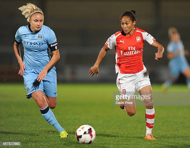Rachel Yankey of Arsenal takes on Steph Houghton of Manchester City during the match between Arsenal Ladies and Manchester City Ladies in the...