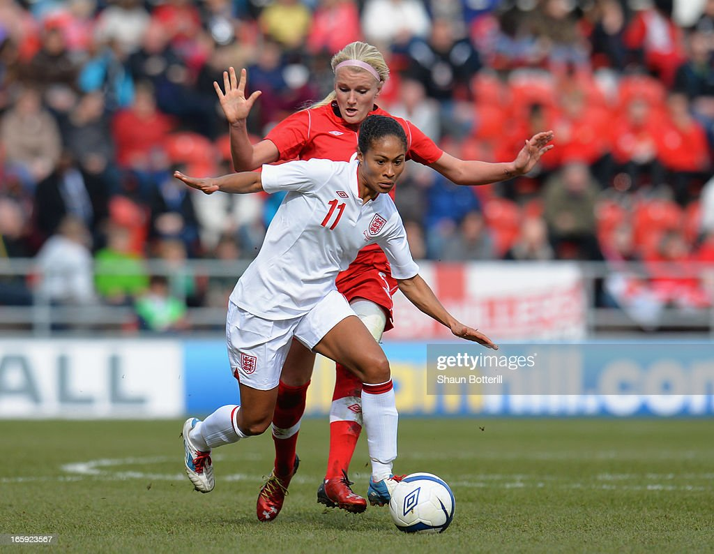 <a gi-track='captionPersonalityLinkClicked' href=/galleries/search?phrase=Rachel+Yankey&family=editorial&specificpeople=235431 ng-click='$event.stopPropagation()'>Rachel Yankey</a> of England breaks away from <a gi-track='captionPersonalityLinkClicked' href=/galleries/search?phrase=Kaylyn+Kyle&family=editorial&specificpeople=7888284 ng-click='$event.stopPropagation()'>Kaylyn Kyle</a> of Canada during the Women's International Match between England Women and Canada Women at The New York Stadium on April 7, 2013 in Rotherham, England.