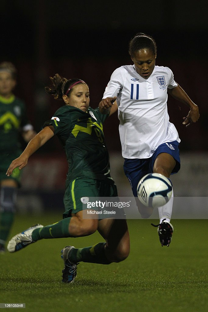 Rachel Yankey (R) of England challenged by Manja Benak (L) of Slovenia during the England v Slovenia UEFA Women's Euro 2013 qualifying match at the County Ground on September 22, 2011 in London, England.