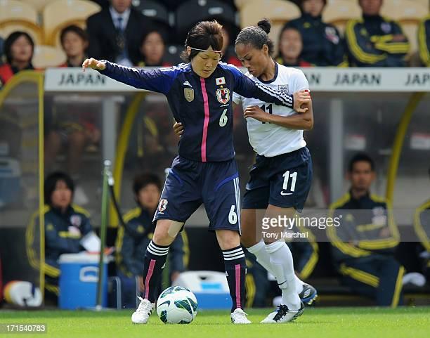 Rachel Yankey of England held off the ball by Mizuho Sakaguchi of Japan during the England Women v Japan Women Womens' International Match at Pirelli...