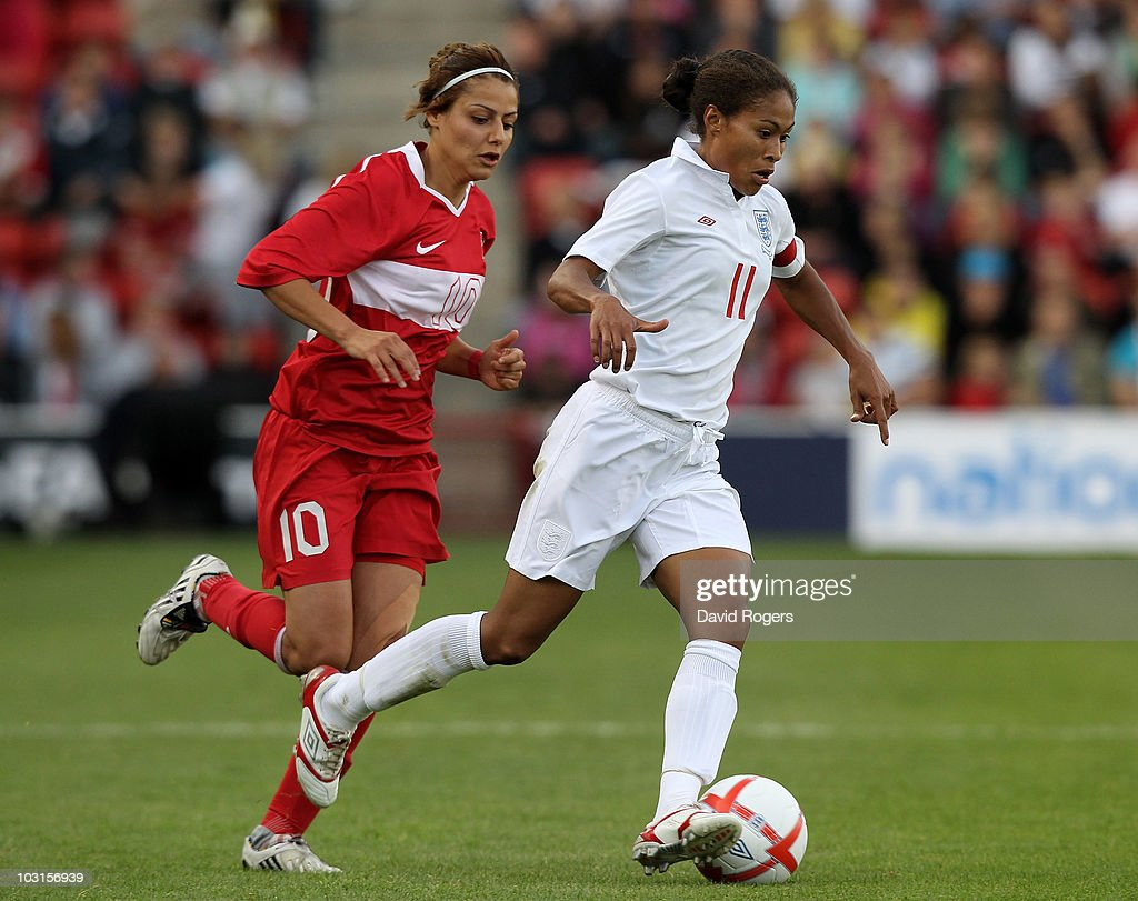Rachel Yankey of England races away from Eylul Elgalp during the FIFA Womens World Cup Qualifiying match between England and Turkey at the Banks's Stadium on July 29, 2010 in Walsall, England.