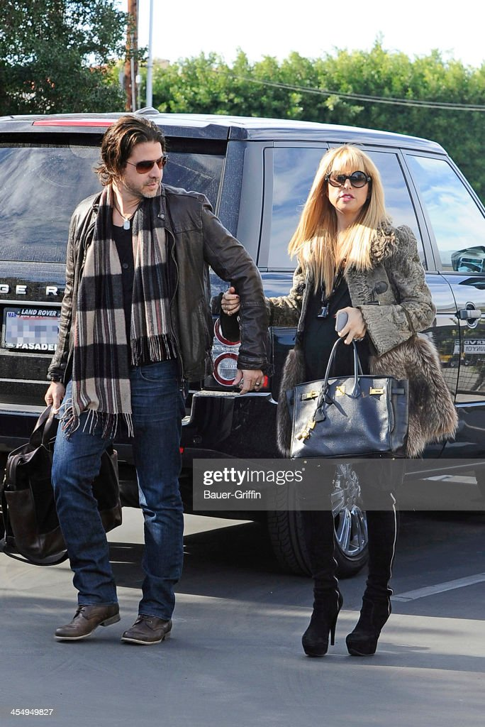 Rachel Zoe and her husband <a gi-track='captionPersonalityLinkClicked' href=/galleries/search?phrase=Rodger+Berman&family=editorial&specificpeople=4104059 ng-click='$event.stopPropagation()'>Rodger Berman</a> are seen in West Hollywood on December 10, 2013 in Los Angeles, California.