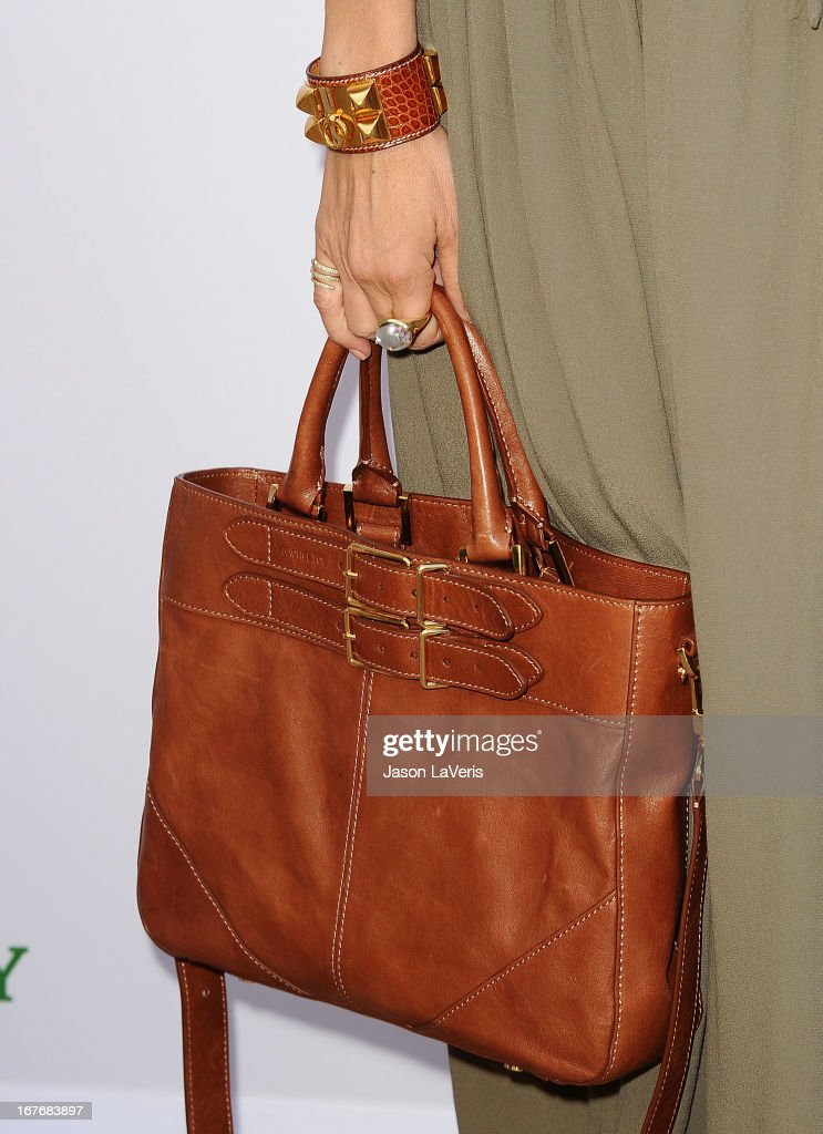 Rachel Zoe (handbag and jewelry detail) attends the Baby2Baby Mother's Day garden party on April 27, 2013 in Los Angeles, California.