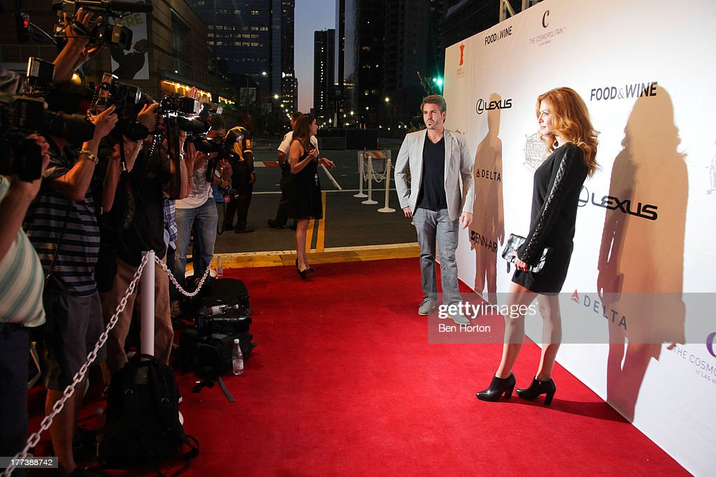 <a gi-track='captionPersonalityLinkClicked' href=/galleries/search?phrase=Rachelle+Lefevre&family=editorial&specificpeople=2538883 ng-click='$event.stopPropagation()'>Rachelle Lefevre</a> (R) and guest attend the Festa Italiana with Giada de Laurentiis opening night celebration of the third annual Los Angeles Food & Wine Festival on August 22, 2013 in Los Angeles, California.