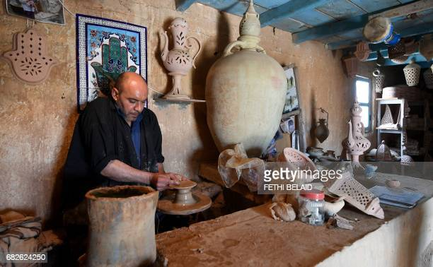 Rachid a 45yearold Tunisian potter shapes clay in a centuryold pottery workshop in Guellala on the southern Mediterranean resort island of Djerba on...