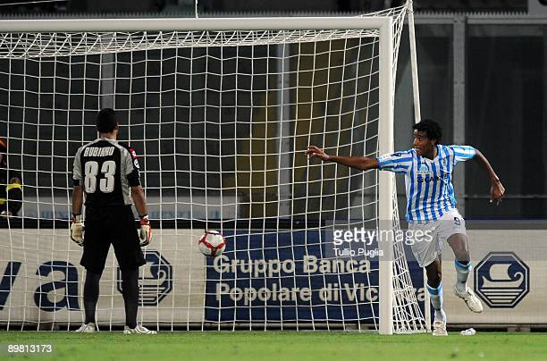 Rachid Arma of SPAL celebrates after scoring a goal while goalkeeper Fernando Rubinho of Palermo reacts during the Coppa Italia TIM Cup match between...