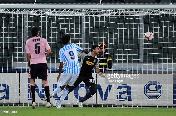 Rachid Arma of SPAL scores a goal past goalkeeper Fernando Rubinho and Cesare Bovo of Palermo during the Coppa Italia TIM Cup match between US Citta...