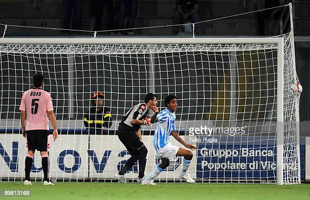 Rachid Arma of SPAL watches the ball hit the back of the goal net as goalkeeper Fernando Rubinho and Cesare Bovo of Palermo react during the Coppa...