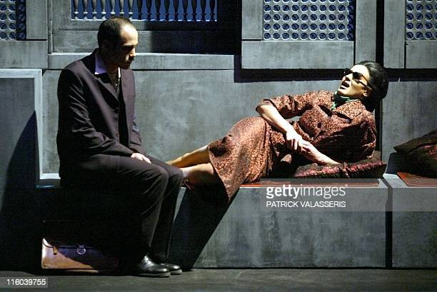 Rachid Benbouchta playing Ahmad Rami and Aicha Sif playing the part of Umm Kulthum adult perform in 'L'astre de l'Orient' directed by Lotfi Ashour...