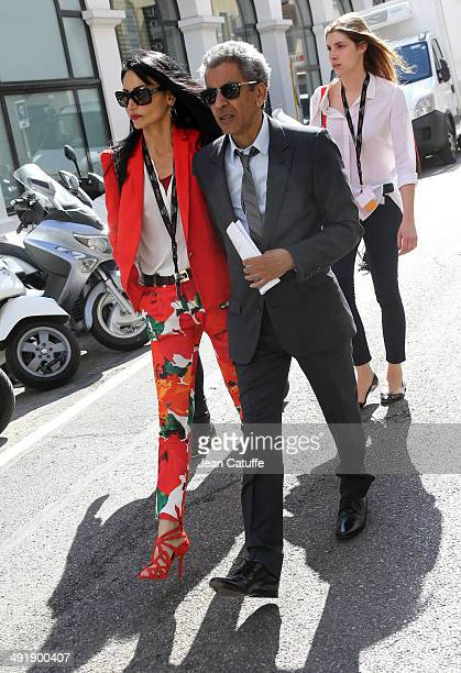 Rachid Bouchareb and his partner Farah are seen strolling on the Croisette Avenue on day 4 of the 67th Annual Cannes Film Festival on May 17 2014 in...