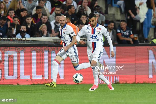 Rachid Ghezzal and Christophe Jallet of Lyon during the Ligue 1 match between Montpellier and Olympique Lyonnais Lyon at Stade de la Mosson on May 14...