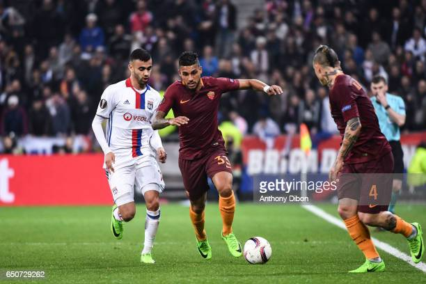Rachid Ghezzal of Lyon and Emerson Palmieri of As Roma during the Uefa Europa League Round of 16 first leg match between Olympique Lyonnais Lyon and...