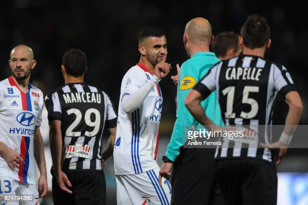 Rachid Ghezzal of Lyon and referee Antony Gautier during the French Ligue 1 match between Angers and Lyon on April 28 2017 in Angers France