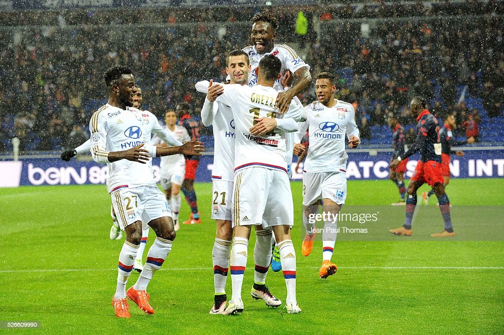 Rachid GHEZZAL of Lyon celebrates his scoring goal with Mapou YANGA MBIWA and Maxime GONALONS during the French Ligue 1 match between Olympique Lyonnais and Gazelec GFC Ajaccio at Stade des Lumieres on April 30, 2016 in Lyon, France.