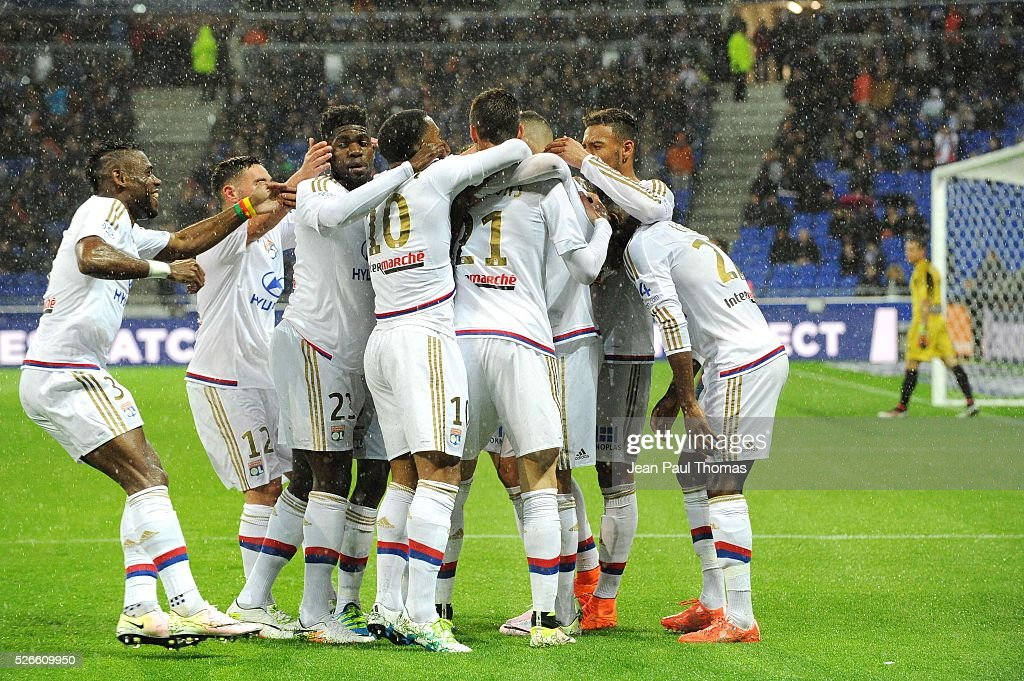 Rachid GHEZZAL of Lyon celebrates his scoring goal with teammates during the French Ligue 1 match between Olympique Lyonnais and Gazelec GFC Ajaccio at Stade des Lumieres on April 30, 2016 in Lyon, France.