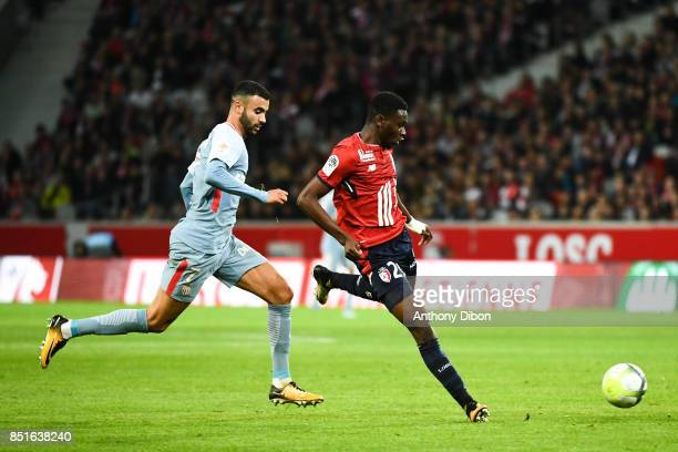 Rachid Ghezzal of Monaco and Rominigue Kouame of Lille during the Ligue 1 match between Lille OSC and AS Monaco at Stade Pierre Mauroy on September...