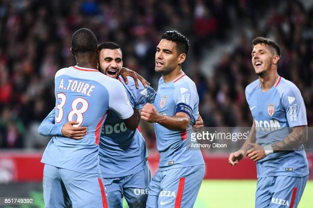 Rachid Ghezzal of Monaco celebrates a goal with Radamel Falcao and Almamy Toure during the Ligue 1 match between Lille OSC and AS Monaco at Stade...