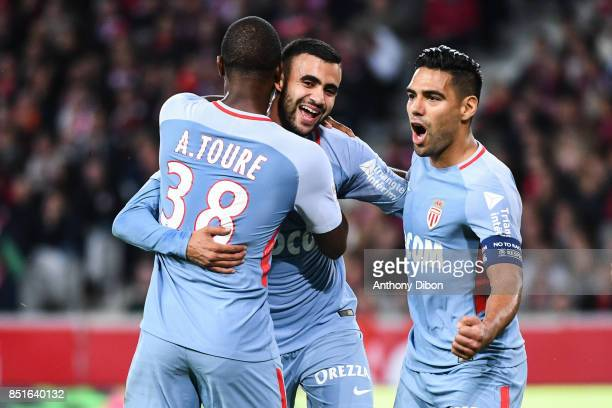Rachid Ghezzal of Monaco celebrates his goal with Radamel Falcao and Almamy Toure during the Ligue 1 match between Lille OSC and AS Monaco at Stade...