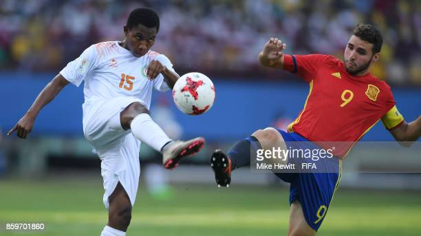 Rachid Soumana of Niger is challenged by Abel Ruiz of Spain during the FIFA U17 World Cup India 2017 group D match between Spain and Niger at the...