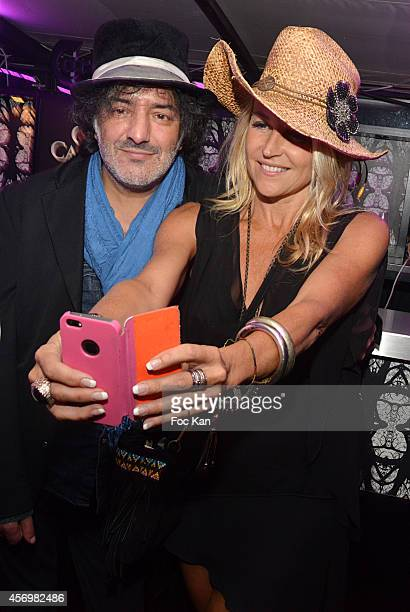 Rachid Taha and a guest attend the James Arch Party At The River's King boat on october 9 2014 in Paris France