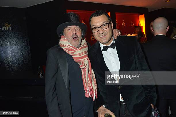 Rachid Taha and a guest attend the VIP Room JW Marriott Day 5 Afro Jack DJ Set at The 67th Annual Cannes Film Festival on May 18 2014 in Cannes France