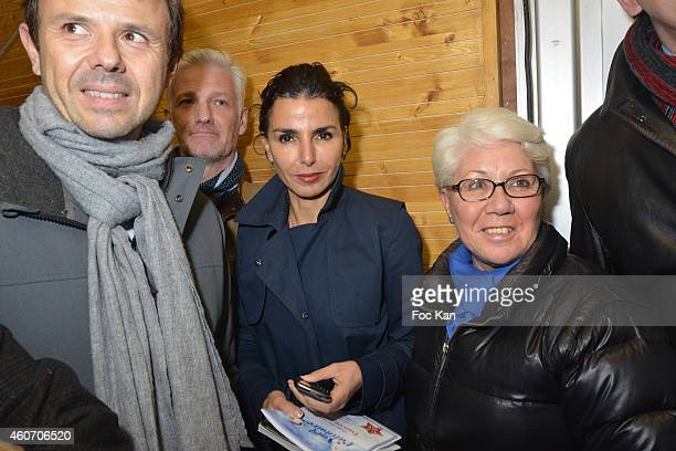 Rachida Dati and guests attend the Tour Eiffel Christmas Ephemeral Skating Rink Launch In Paris on December 19 2014 in Paris France