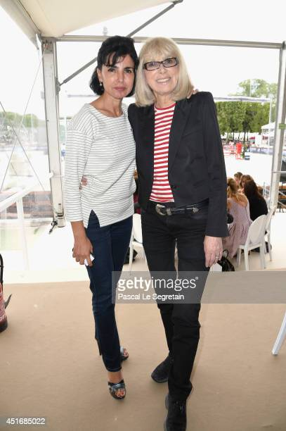 Rachida Dati and Mireille Darc attend the Paris Eiffel Jumping presented by Gucci at ChampdeMars on July 4 2014 in Paris France