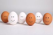 A group of smiling brown and white eggs representing racial harmony, diversity, integration, and tolerance.