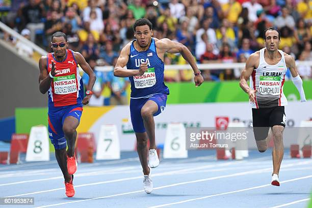 Raciel Gonzalez Isidoriaof Cuba Gianfranco Iannotta of the USA and Ahmad Ojaghlou of Iran compete in the men's 100m T47 on day 3 of the Rio 2016...