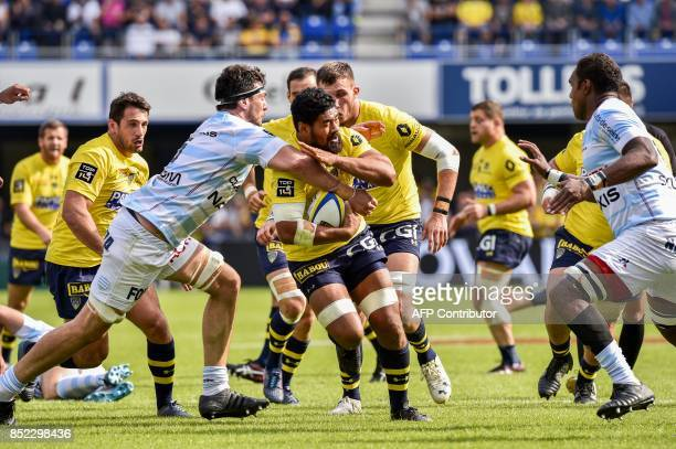 Racing 92 Argentinian lock Manuel Carizza tackles Clermont's New Zealander centre Fritz Lee during the French Top 14 Rugby Union match ASM Clermont...