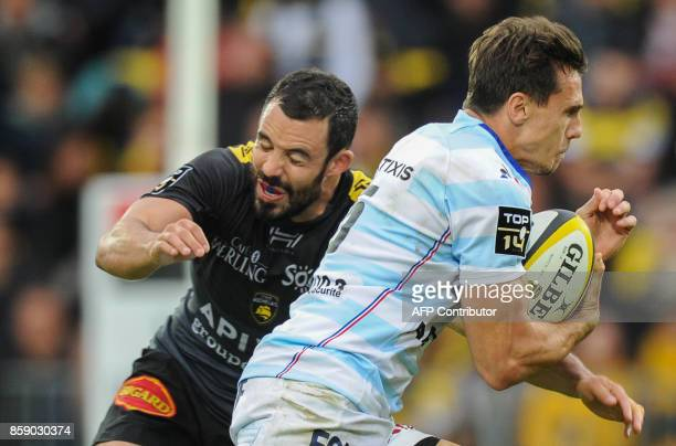 Racing 92 Argentinian wing Juan Imhoff runs with the ball during the French Top 14 rugby union match between La Rochelle and Racing 92 on October 8...