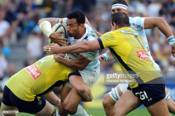 Racing 92 New Zealand centre Casey Laulala vies with Clermont's French lock Arthur Iturria and Clermont's French prop Raphael Chaume during the...