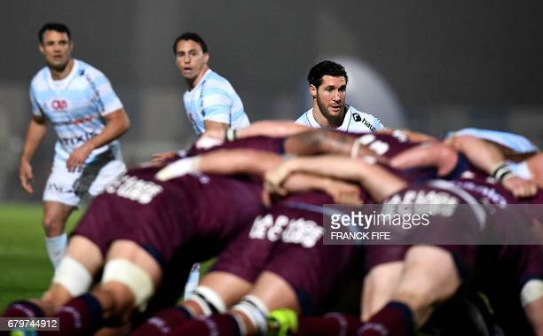 TOPSHOT Racing 92 New Zealand flyhalf Dan Carter Racing 92 Argentine wing Juan Imhoff and Racing 92 French scrumhalf Maxime Machenaud react during...