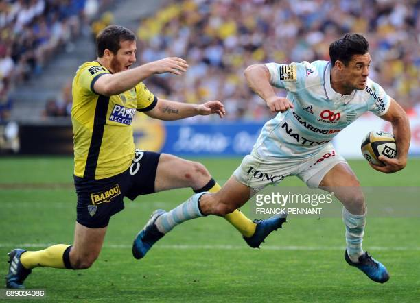 Racing 92 New Zealand flyhalf Dan Carter vies with Clermont's French flyhalf Camille Lopez during the French Top 14 union semifinal rugby match...