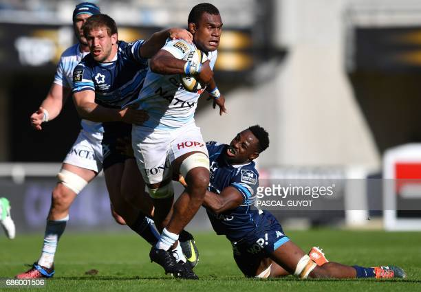 Racing 92's Fijian lock Leone Nakarawa vies with Montpellier's South African François Steyn and Montpellier's French flanker Fulgence Ouedraogo...